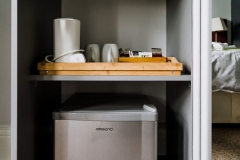 Room amenities, mini fridge and tray with coffee, tea, electric kettle, drier
